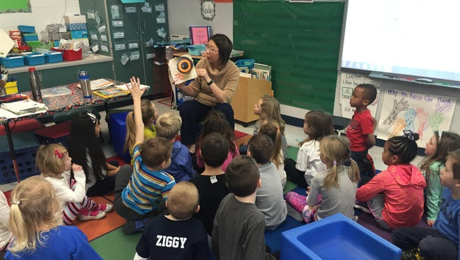 """Students at Traeger Elementary kicked off Read Across America Week with a Leap Day surprise. Teachers """"leaped"""" to different classrooms for the morning meeting."""