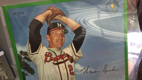 This Auravision baseball record card features Warren Spahn. It's a 33 rpm record made to look like a baseball card, with photo on the front and player bio and stats on the back.