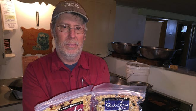 In the Sidney basement kitchenette where he makes it, Jody Kappel show off bags of Chuck and James granola.