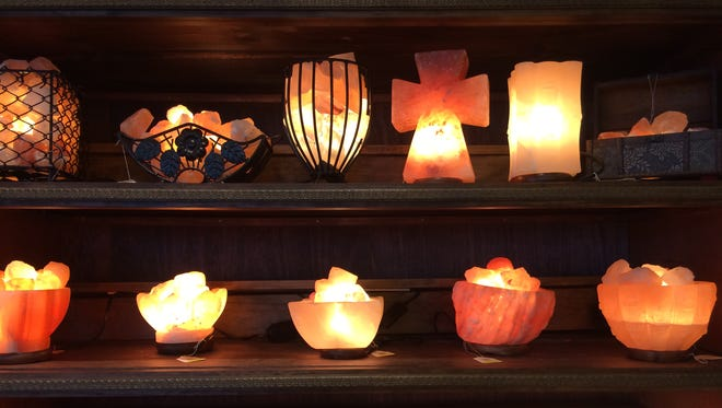A collection of Himalayan salt rock lamps on display at Consign It! in Bay Park Square Mall in Ashwaubenon.
