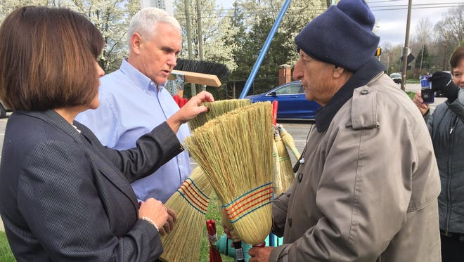 Gov. Mike Pence and his wife, Karen, bought brooms and offered encouragement for the Broom Guy, Jim Richter, on Tuesday, April 5, 2016.