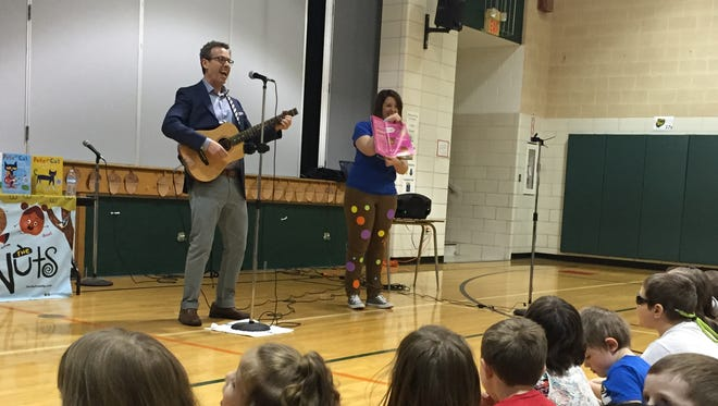 "Award-winning children's book author Eric Litwin performs his book ""The Nuts: Sing and Dance in Your Polka-Dot Pants"" at Eastview Elementary School on Monday."