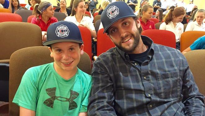 Nathan Boyer, 13, and his baseball coach, Isaac Wenrich, 26.