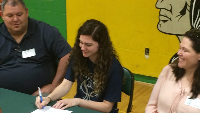 Surrounded by her parents, Mardela's Taylor Ross signed her letter of intent to play basketball at Goldey-Beacom.