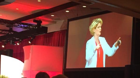 Motivational speaker Tami Evans speaks at the Go Red for Women luncheon in Louisville.