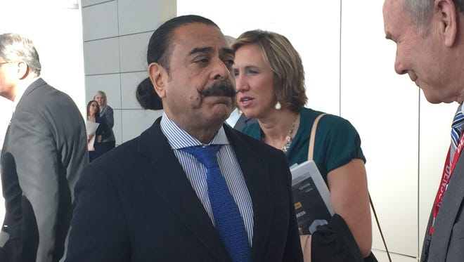Flex-N-Gate owner Shahid Khan talks to reporters after speaking at SAW World Congress in Detroit in April 2016.