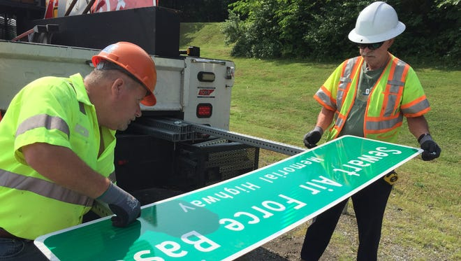 Paul Underhill, right, and Robert Smith put together a TDOT road sign that will rename a 1-mile section of Sam Ridley Parkway in honor of Sewart Air Force Base.