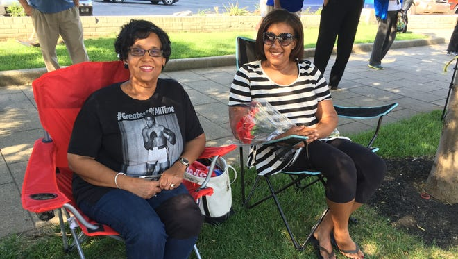 Teejan Booker, 59, and Amber Duke, 34, sat their red lawn chairs and red flowers in the shade on Broadway Friday.