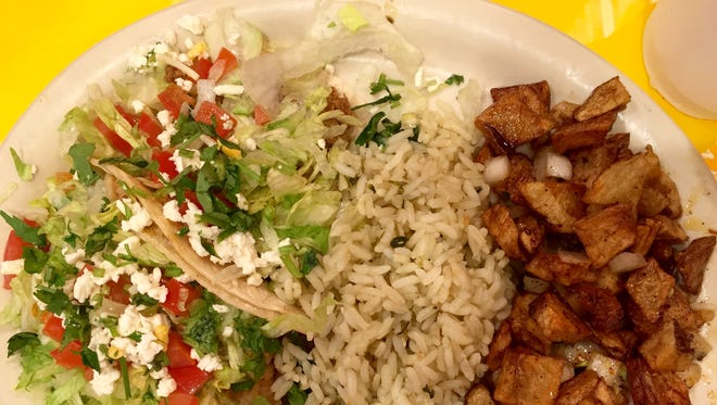 A taco plate with rice and fried potatoes from Fuzzy's Taco Shop.