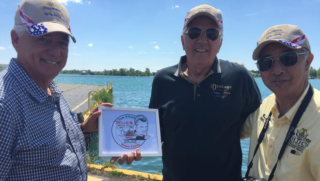 From left, George Simon Jr., Tom D'Eath and Ray Dong commemorate D'Eath's 1976 powerboat victory.