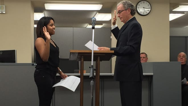 Mike Spence, right, was sworn in as Caddo Clerk of Court on Thursday, then he swore in Breaneshia Thompson as his first official hire. Ben Politz and the Reverend Charles Glorioso look on.