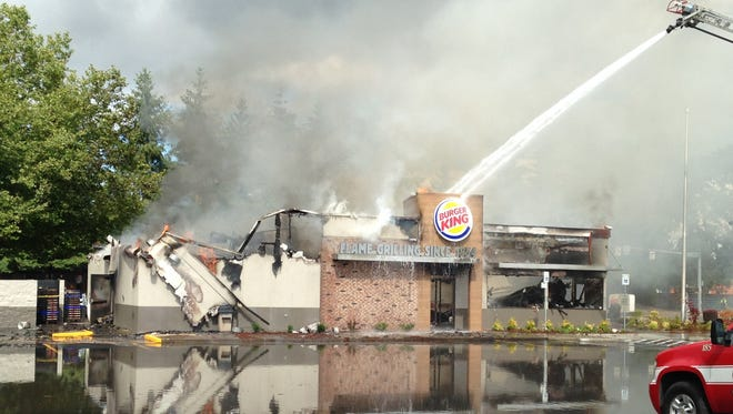 Albany firefighters put out a fire at a Burger King on SE Geary Street. The street is closed at 14th Avenue.
