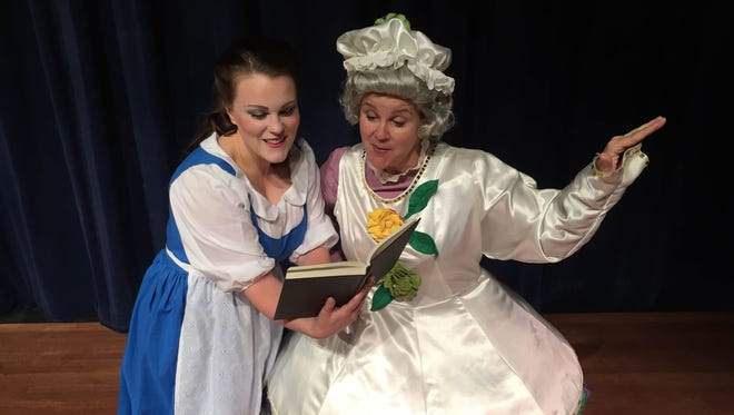 """Dani Boal, left, is Belle and Melanie Hall is Mrs. Potts in Urbandale Community Theatre's """"Beauty and the Beast."""""""