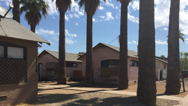 A man was found dead in the attic of an apartment home in the 2100 block of West Washington Street in Phoenix on Tuesday, July 26, 2016. The apartment is in the middle building shown.