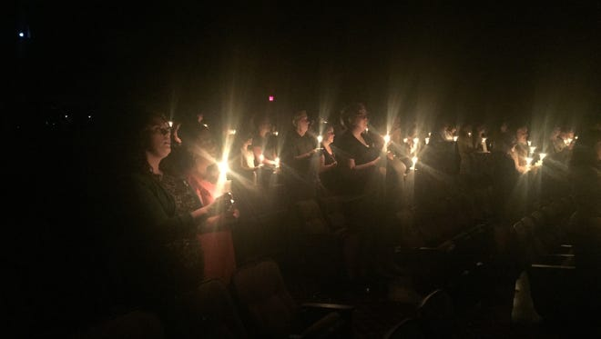 Community members and classmates light candles at a vigil July 30, 2016, at the Queen Creek Performing Arts Center to remember Kyle and Emily Gerhart, who were found dead July 25, 2016.