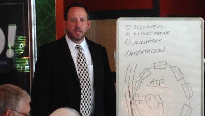 Dr. Shannon Bone used a markerboard to illustrate how blood sugar gets into cells in the human body.