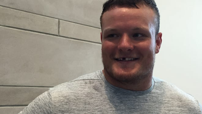 U-M defensive lineman Ryan Glasgow is all smiles, even without a tooth.