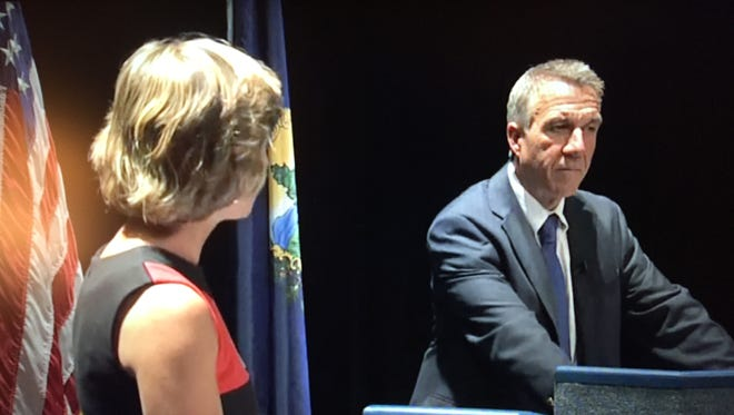 Democratic candidate for governor Sue Minter, left, meets Republican candidate Phil Scott in a televised debate sponsored by Vermont-NEA on Monday, Aug. 22, 2016.