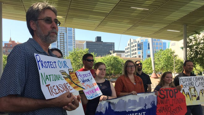 Arizona State University professor and activist Paul Hirt leads a group of Environment Arizona ralliers on Wednesday, Aug. 24.