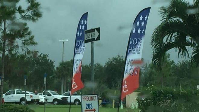 Signs at Precinct 205 on a gloomy election day on Aug. 30, 2016.