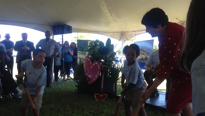 Le Bonheur CEO Meri Armour, right, breaks ground on a new outpatient center in Jackson with Aiden Culpepper, 6, and Elsie Ogbeifun, 4.