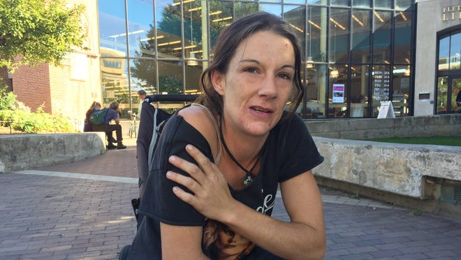Jaice Plumb of Burlington watched her young sons play outside of Fletcher Free Library on Wednesday, Sept. 28, 2016. She practiced what she thought was safe co-sleeping with her oldest child, and she believes it created a stronger parental bond.