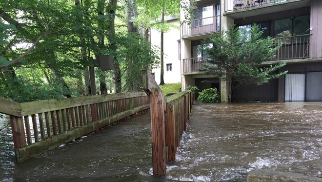 Floodwaters rise from Tony Tank Pond into the ground floor units at Canal Woods in Salisbury on Thursday, Sept. 29, 2016.
