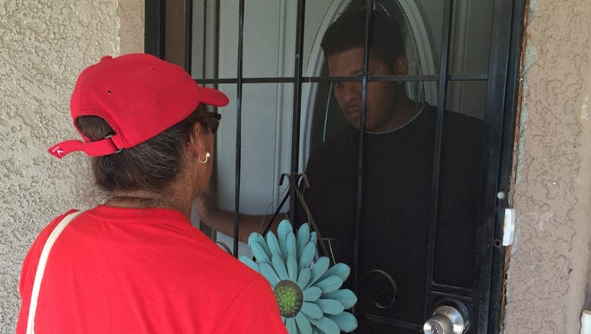 Maricruz Ramirez with the Bazta Arpaio campaign knocked on about 50 doors in central Phoenix on the morning of Nov. 5, 2016, encouraging people to vote.