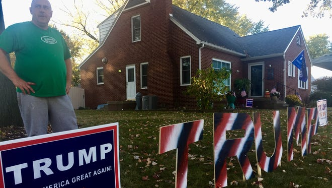John Hamilton spent part of Sunday rebuilding pieces of his Donald Trump yard signs after some were trampled or taken over the weekend.