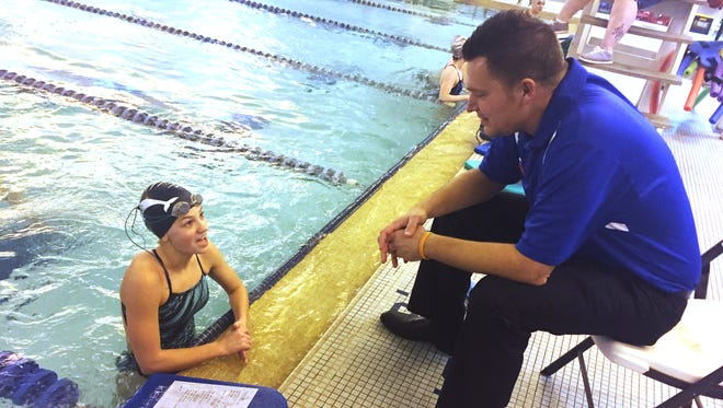 Kylee Hicks talks to Central Catholic swimming coach Chip Comery prior to workouts at the YWCA.