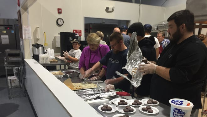 Volunteers prepare a Thanksgiving meal at Halo on Thursday