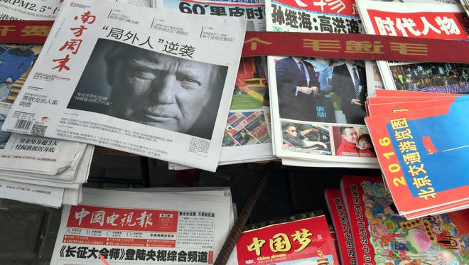 A Beijing news stand shows a  newspaper with a photo of President-elect Donald Trump on Nov. 10, 2016. China awoke Dec. 5, to criticism from Trump on Twitter, days after it responded to his telephone call with Taiwan's president.