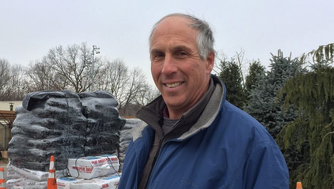 David Nolletti of Gedney Farms Nursery prepared for a flood of Christmas tree sales ahead of snow predicted for the area on Dec. 11, 2016.