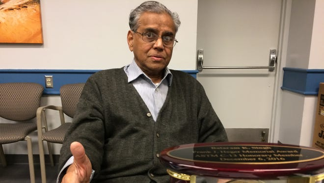 B.K. Singh, a state transportation engineer, is retiring after 51.5 years of work. Few workers experience that longevity. On Dec. 9, 2016, he shows the Frank. J. Heger Memorial Award given to him by the American Society for Testing and Materials for his work on quality standards over the years.
