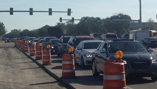 Traffic was at a standstill on Wickham Road Thursday as lanes were reduced for construction.