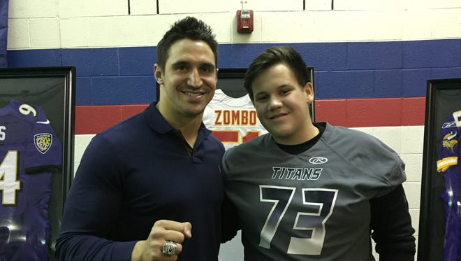 Former Sterling Heights Stevenson football standout and current Kansas City Chiefs LB Frank Zombo, left, poses for a picture with Stevenson freshman Joe Lombardo at a jersey ceremony in Sterling Heights on Thursday, Jan. 26, 2017.
