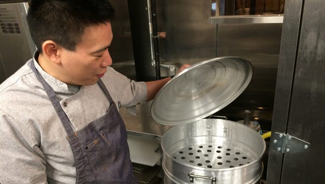 Chef Chris Cheung shows off his multi-tier steamer at Tànsuŏ, a new Chinese restaurant in the Gulch that opens March 13.