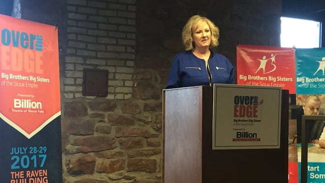 """Jami Gates, executive director for Big Brothers Big Sisters of the Sioux Empire, announces the """"Over the Edge"""" fundraiser."""