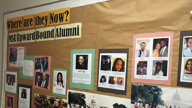 A bulletin board outside MSU's Upward Bound office highlights some of the students who have participated in the program during its more than 50 years of existence. Michigan State University plans to continue helping Lansing students prepare for college despite losing its federal funding to do so, Lansing School District officials said.