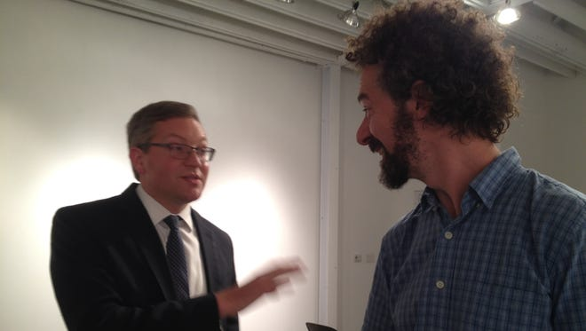 Attorney Adam Eckstein, left, discusses legal concepts with artist Cedar Nordbye after a session at Crosstown Arts.
