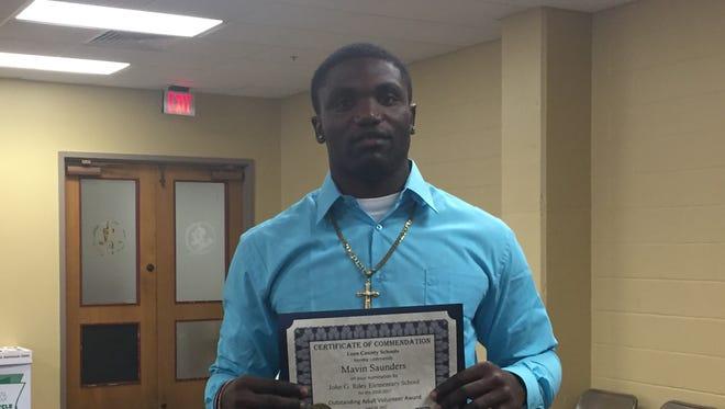 FSU tight end Mavin Saunders wins the Outstanding Adult Volunteer Award from Riley Elementary School