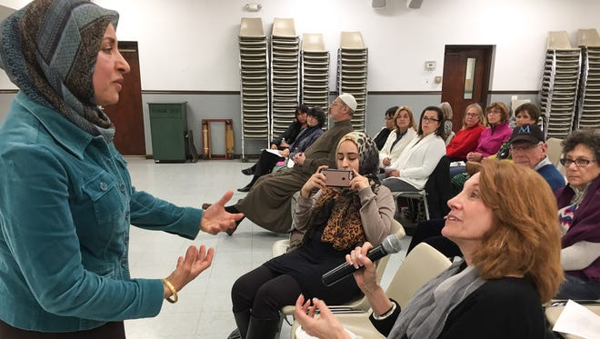 "Heba Elkhateeb of the Islamic Society of Central Jersey and Rutgers University, answers the question of South Brunswick Human Relations Commission Vice Chairwoman Jodi Marcou at ""Faith, Conversation and Coffee"" on April 25 at the mosque. The series will continue May 10 at Congregation B'nai Tikvah in North Brunswick."