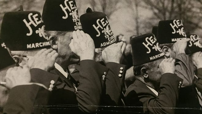A crowd of Shriners salute the flag at the groundbreaking ceremonies for the new Shriners Hospital adjoining the Greenville Memorial Hospital in 1985.