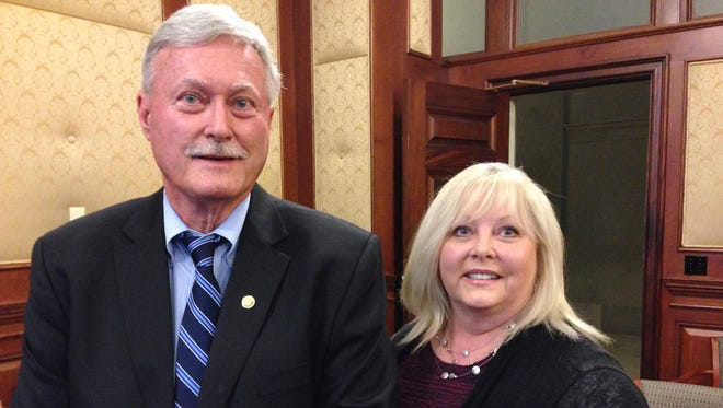 In this May 1, 2017 photo, Dr. Tricia Derges, right, stands with Missouri Rep. Lynn Morris after they testified in support of legislation expanding eligibility for Missouri's assistant physician law at a Senate committee hearing at the state Capitol in Jefferson City, Mo. Derges' application had been denied because Missouri took so long to implement the 2014 assistant physician law, but she could become eligible under new legislation recently passed by the Legislature. (AP Photo/David A. Lieb)