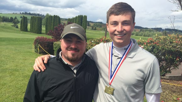 West Salem golfer Andrew Eyre (right) with coach Mike Baker after Eyre places fourth at state Tuesday.