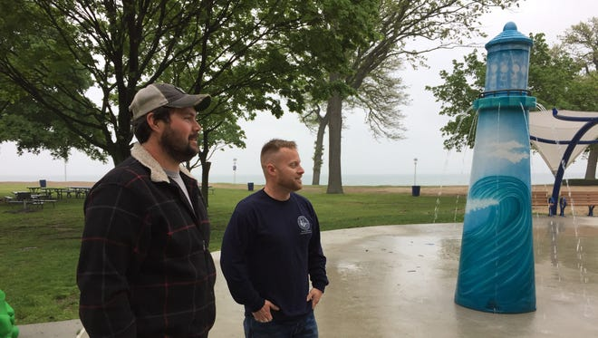 Port Huron Parks and Recreation employees Chad Dell, left, and Dan Gerstenberger check out the splash pad at Lakeside Beach. The popular water feature is open for the Memorial Day weekend.