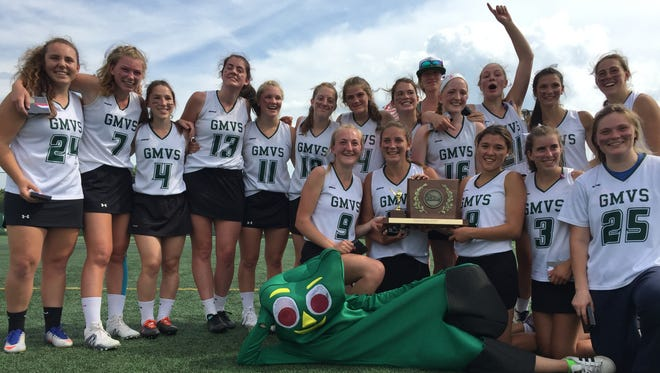 Green Mountain Valley and its Gumby mascot, post with the Division II high school girl lacrosse championship trophy on Saturday at Virtue Field.