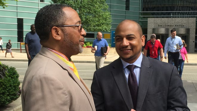 Lenny Barnes, vice president of Heritage Vision Plans, left, and Ken Harris, president of the National Business League, talk about the organization at Campus Martius in Detroit on Monday, June 19, 2017.