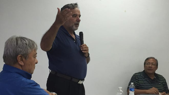 Tim Rohr, advocate and blogger of Catholic church issues, addresses Concerned Catholics of Guam members during a meeting Wednesday night, while Gerald Taitano, left, and Concerned Catholics president David Sablan, right, look on.