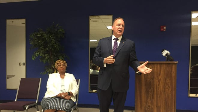 """Wilmington Police Chief Robert Tracy speaks to city residents on July 18 alongside City Council President Hanifa Shabazz at the first event on the council's listening tour called """"Community Conversations with City Council."""""""
